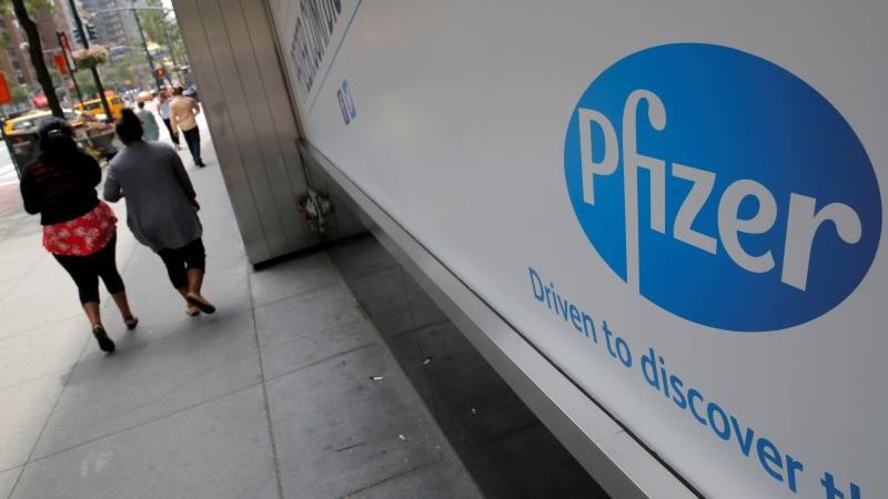 Dow gives 834 points on Pfizer`s COVID 19 vaccine state of the art as Nasdaq dips.